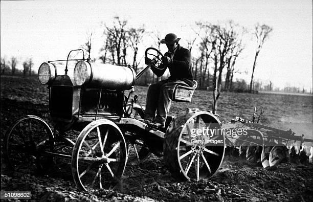 A Model T Pulls A Disc Plow On A Farm In 1915