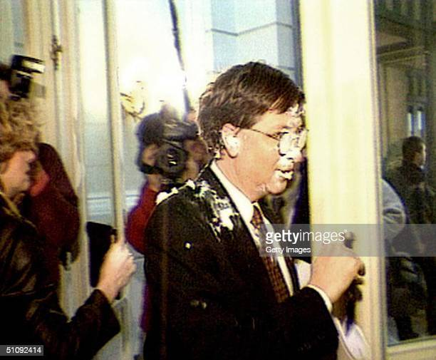 File Photo: A Video Still Of Microsoft Mogul Bill Gates Walking Past Reporters After He Being Hit In The Face By 4 Fresh Cream Tarts By The Infamous...