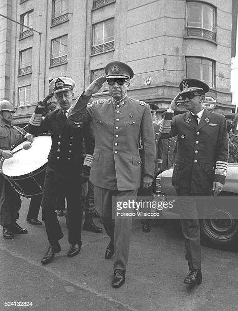 Admiral Toribio Merino, General Augusto Pinochet, and Air Force General Leigh salute while walking to join the Te Deum on September 18, Independence...