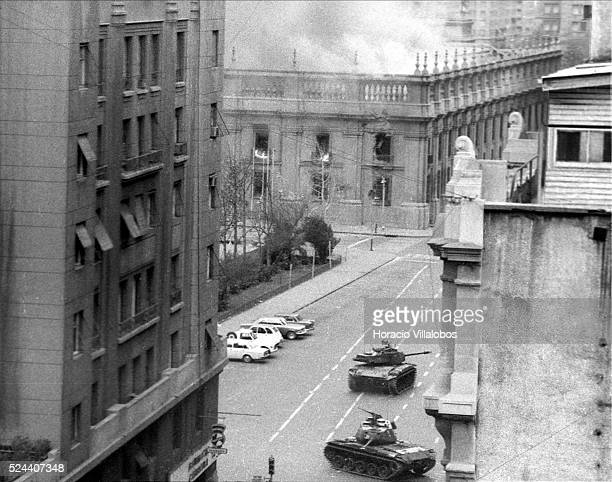 After being bombed and rocketed by the Chilean Air Force planes La Moneda burns Photographed during the aftermath of the coup d'etat led by Commander...
