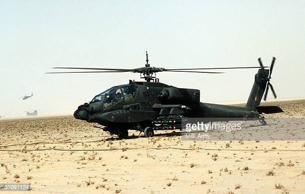 An Ah64A Apache AntiTank Helicopter Of The Armed With Agm114A Hellfire AntiTank Missiles Is Prepared For A Mission During Operation Desert Storm...