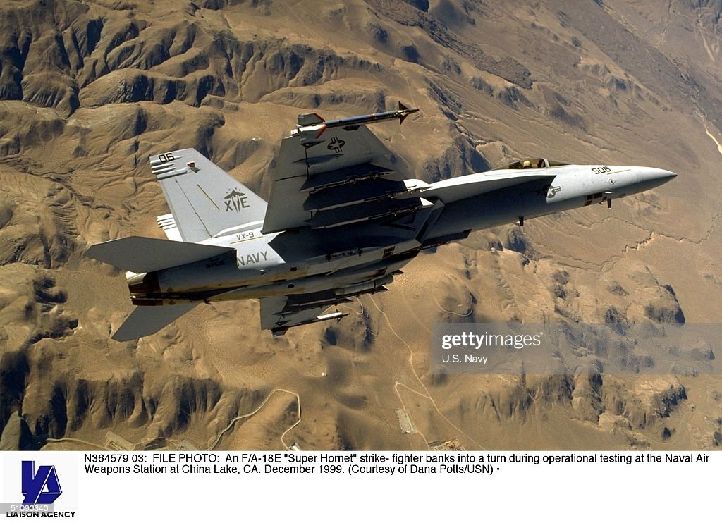 An F/A 18E Super Hornet Strike Fighter Banks Into A Turn During Operation : News Photo