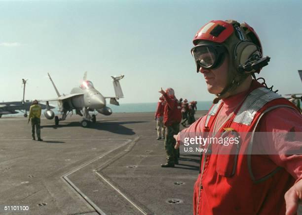 Aviation Ordnanceman Douglas Park Signals During An Ordnance De-Arming Exercise On Board The Aircraft Carrier USS Carl Vinson January 3, 1999. Vinson...