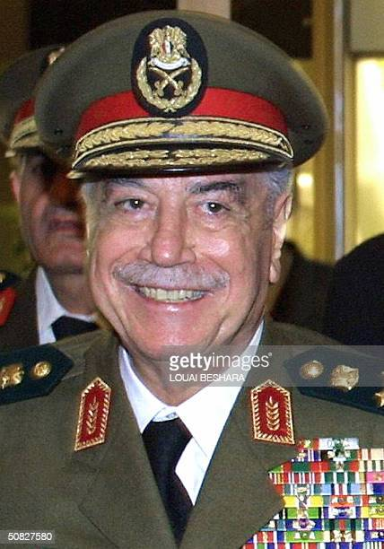 File photo dated 03 March 2001 shows Syrian Defence Minister Mustapha Tlass smiling after a meeting with his Greek counterpart Akis Tsohatzopoulos in...