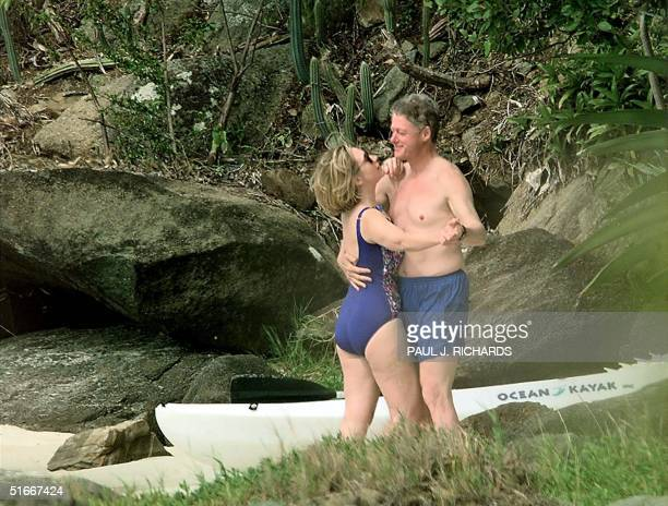 File photo dated 04 January 1998 shows US President Bill Clinton and First Lady Hillary Clinton dancing on the beach of Megan Bay, St. Thomas, US...