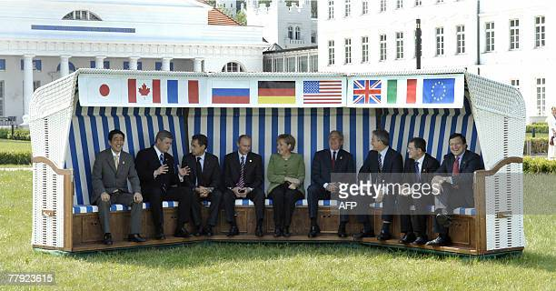 File photo dated 07 June 2007 shows then G8 Heads of State posing in a giant beach chair for a family picture in front of the Kurhaus building in...