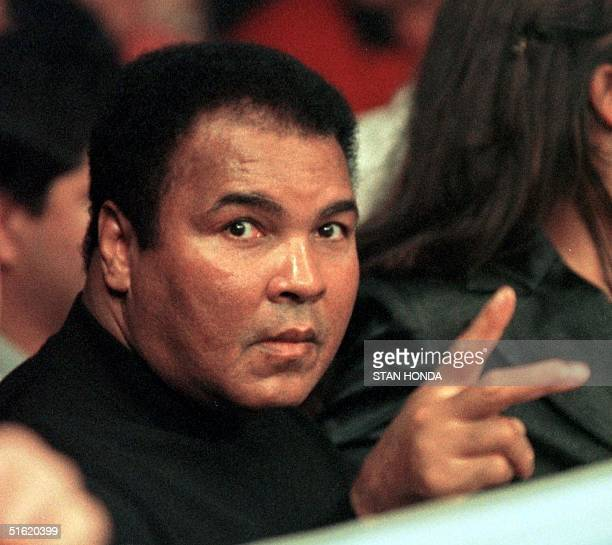 File photo dated 08 October 1999 shows boxing great Muhammad Ali at the ringside before the match of his daugher Laila Ali and April Fowler at the...