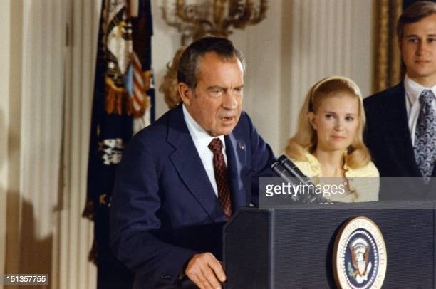 File photo dated 09 August 1974 of the 37th President of the United States Richard Nixon as he bids farewell to the White House staff Family members...