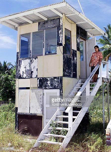 File photo dated 11 September 2001 of air traffic controller Muraea Tiaoti at the downatheel Bonriki International Airport control tower on Tarawa in...