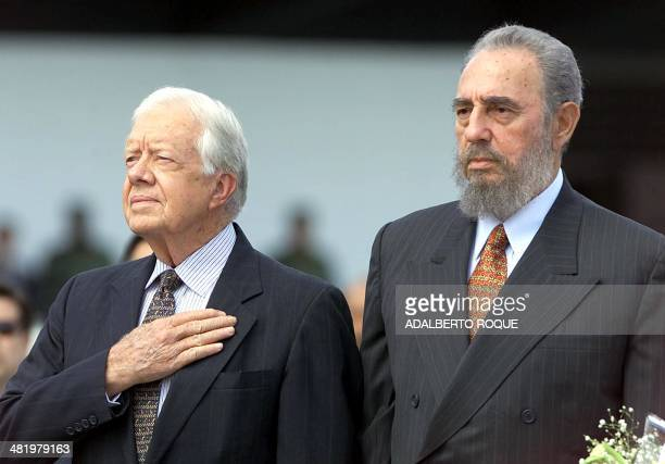 File photo dated 12 May 2002 shows former US president Jimmy Carter and Cuban President Fidel Castro listening to the US national anthems after...