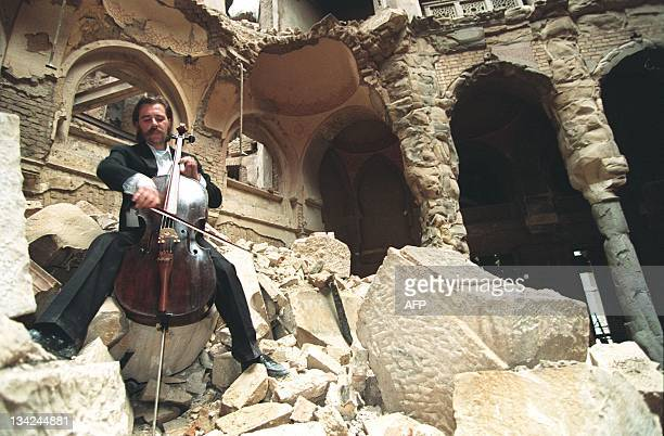 File photo dated 12 September 1992 shows Cellist Vedran Smailovic playing Strauss in the bombed National Library in Sarajevo