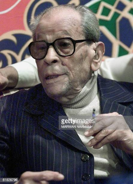 File photo dated 13 December 2000 shows Egyptian novelist Naguib Mahfouz smoking a cigarette during his birthday party in Cairo Mahfouz born in 1911...