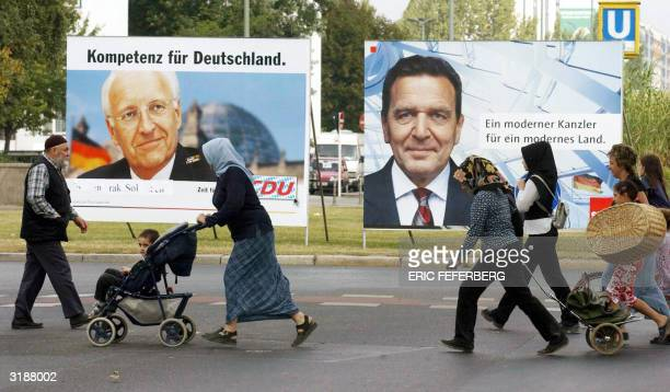 STORY 'GERMANYHEADSCARFRELIGION' File photo dated 14 September 2002 shows Muslim women wearing headscarves crossing the street in front of election...