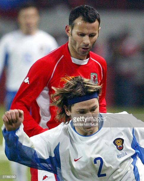 A file photo dated 15 November 2003 shows Russian soccer player Vadim Evseev been challenged by Ryan Giggs from Wales during their UEFA EURO 2004...