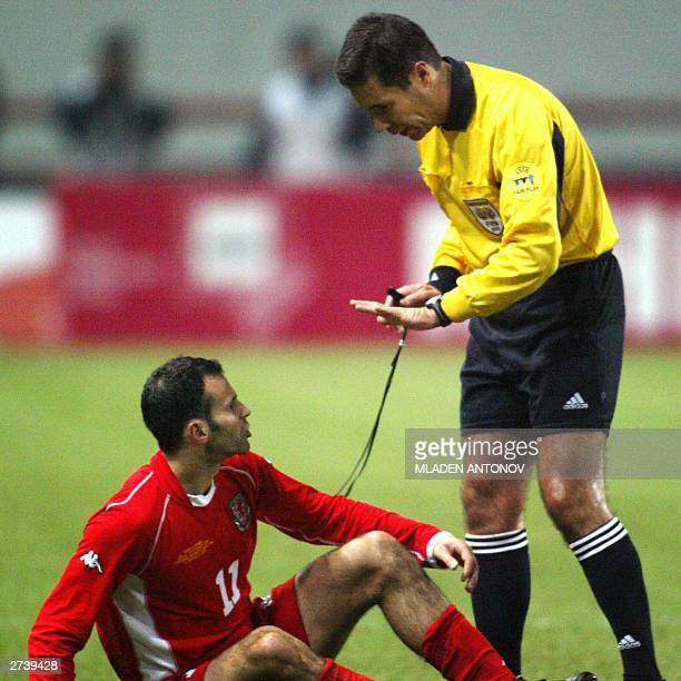 A file photo dated 15 November 2003 shows Ryan Giggs from Wales arguing with Portugese referee Lusiliu Batista during the UEFA EURO 2004 playoff...