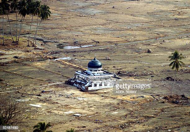File photo dated 19 January 2005 shows a mosque on the tsunamidevastated west coast of Aceh a month after a powerful tsunami hit the region on...