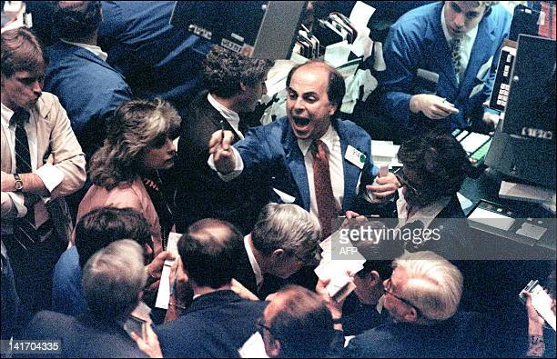 File photo dated 19 October, 1987 shows a trader on the New York Stock Exchange shouting orders as stocks were devastated during one of the most...