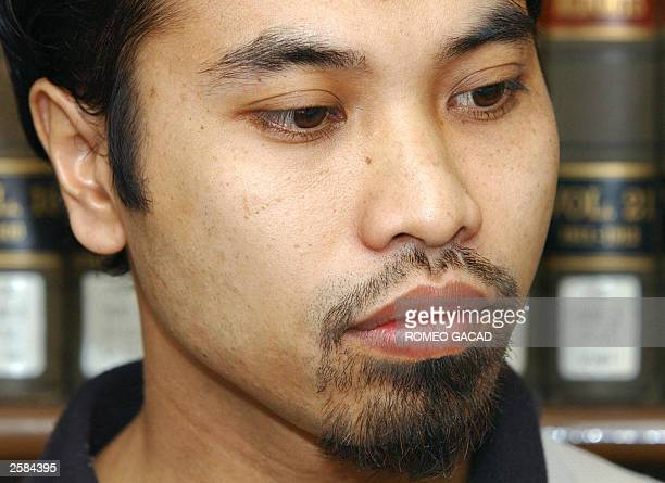 File photo dated 19 September 2002 shows convicted and escaped Indonesian Fathur Rohman alGhozi appearing before the Philippine Department of Justice...