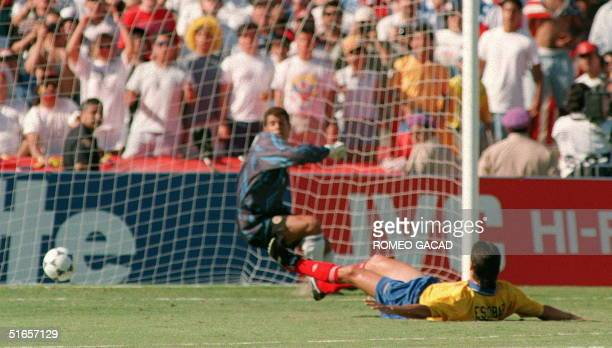 File photo dated 22 June 1994 shows Colombia defender Andres Escobar laying on the pitch as he deflects a shot by John Harkes of the US into his own...