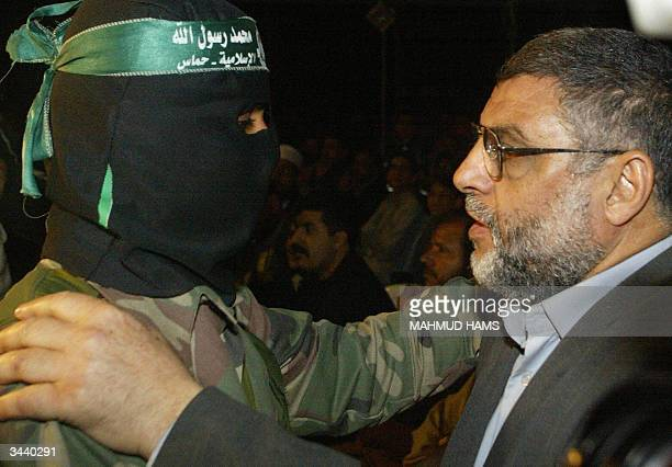 File photo dated 24 March 2004 shows new leader of the radical movement Hamas Abdelaziz alRantissi tapping on the shoulder of a Hamas militant at the...