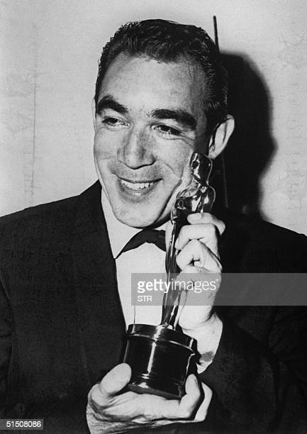 File photo dated 27 March 1957 shows US actor Anthony Quinn showing his Oscar for best actor in a supporting role in 'Lust for Life' during the 29th...