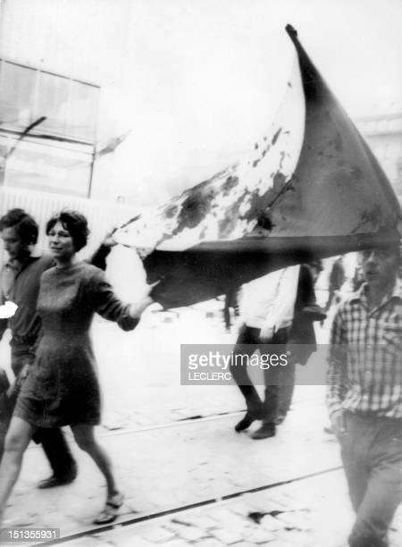 File photo dated August 1968 of Prague residents walking, holding a bloodstained Czechoslovakian National flag, in the streets of Prague after...