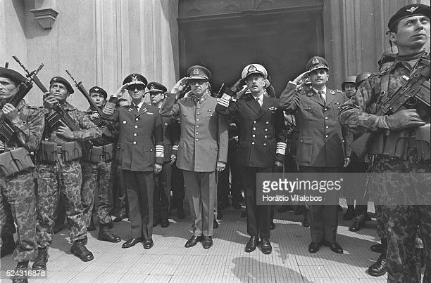 General Mendoza, in the middle of the Carabineros, is at right as the military junta salutes at the end of the Te Deum, after the coup d'etat led by...