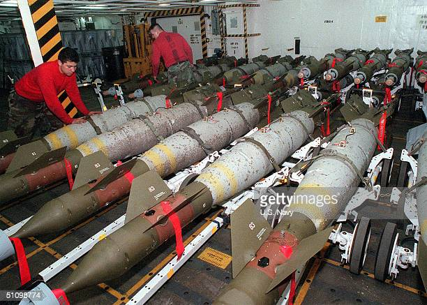 Members Of The Forward Magazine Crew Prepare A Group Of Gbu-16 Bombs For Transport To The Flight Deck Of The Aircraft Carrier USS Carl Vinson...
