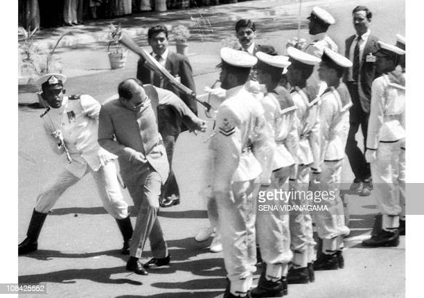 File photo of former Indian Prime Minister Rajiv Gandhi ducking a rifle butt attack by a Sri Lankan naval rating during an honour guard in Colombo 30...
