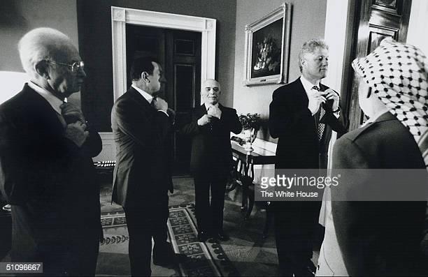 Photo Of President Bill Clinton With Israeli Prime Minister Yitzhak Rabin , Egyptian President Hosni Mubarak And Jordan's King Hussein Adjusting...