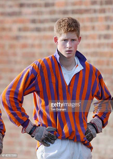 Prince Harry playing for the team The Oppidans in the traditional Eton wall game at his school Eton College He is wearing a rugby shirt with his...