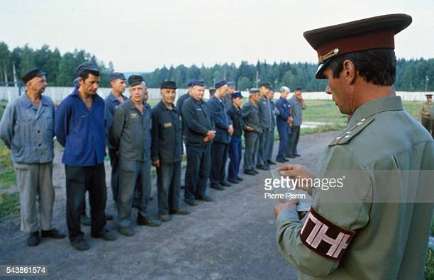 Prisoners in the Soviet Union's last remaining gulag or forced labor camp, Perm 35, await orders in the prison yard. --- Photo by P. Perrin/Corbis...
