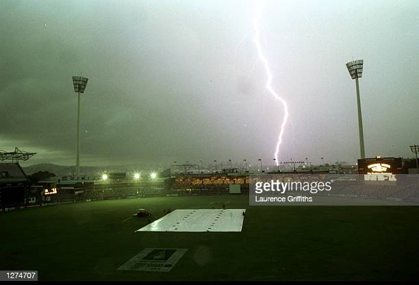 A file Photo shows a lightning strike as a massive thunder storm stops play in the first test between England and Australia at the Gabba on November...