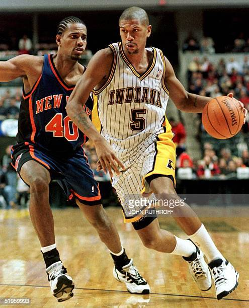 File photo shows New York Knicks Kurt Thomas guards Indiana Pacer Jalen Rose as Rose drives towards the basket 25 December 1999 at the Conseco...