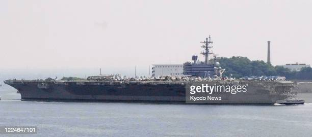 File photo shows the U.S. Aircraft carrier Ronald Reagan leaving Yokosuka base near Tokyo on June 8 to conduct military exercises in the South China...