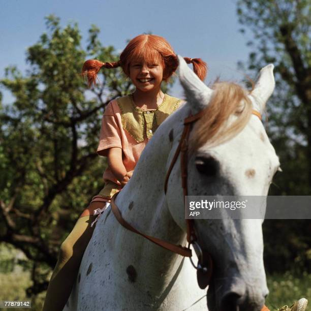 A file photo taken 01 May 1969 shows a still from the movie Pippi Longstocking with Inger Nilsson as Pippi on her horse Little Gubben Swedish writer...