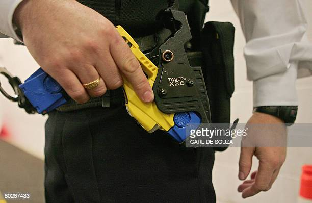 A file photo taken 05 December 2007 shows a British police officer holding a taser gun during a training session at the Metropolitan Police...