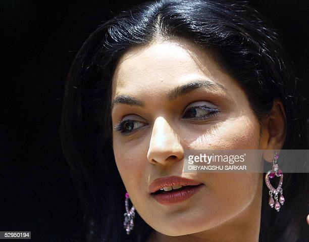 WITH ENTERTAINMENTINDIAPAKISTANBOLLYWOODMEERA File photo taken 05 May 2005 in Bangalore shows Pakistani actress Meera as she poses for photographers...