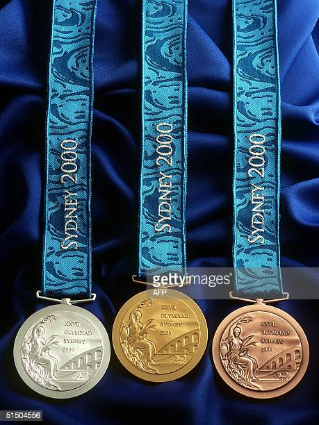 A file photo taken 14 August 2000 in Sydney shows the official Olympic medals issued a few weeks ahead of the opening of the 2000 games Greek...