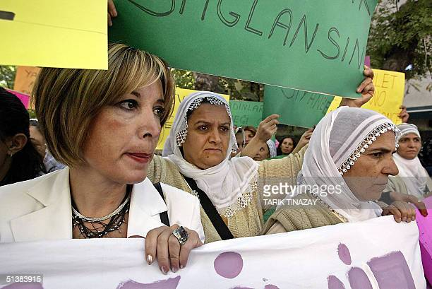 A file photo taken 14 September 2004 shows Turkish women marching on parliament to protest against a government move aiming to make adultery a...