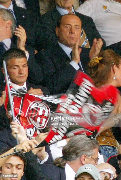 A file photo taken 16 May 2004 shows Italian Prime Minister and AC Milan president Silvio Berlusconi watching his team playing against Brescia during...