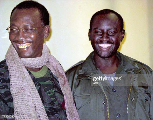 A file photo taken 17 December 2006 shows Chad's President Idriss Deby meeting with then rebel leader Mahamat Nour Abdulkerim heading the United...