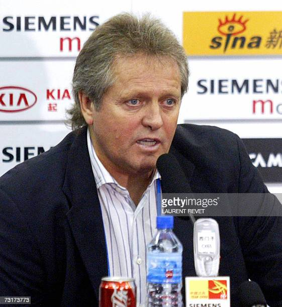 A file photo taken 17 November 2004 shows then China's national football team's Dutch coach Arie Haan answering questions during a press conference...