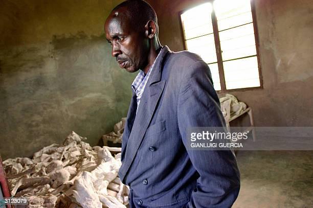 A file photo taken 28 February 2004 shows Emanuel Murangira caretaker at the Rwandan Genocide memorial of Murambi stands close to the skeletons of...