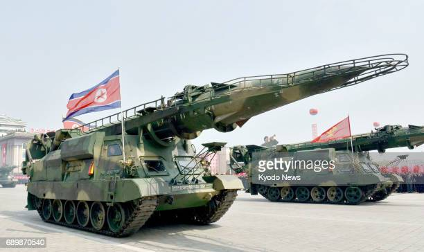 File photo taken April 15 in Pyongyang shows ballistic missiles with a precision control guidance system on display during a military parade ==Kyodo