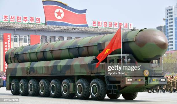 File photo taken April 15 shows a vehicle carrying what appears to be a new intercontinental ballistic missile at a military parade at Kim Il Sung...