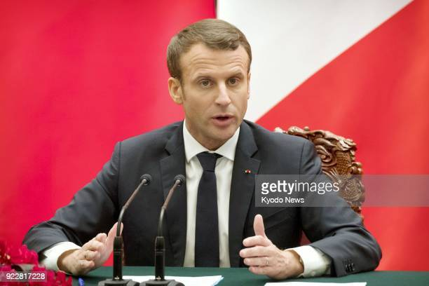 File photo taken at the Great Hall of the People in Beijing on Jan 9 shows French President Emmanuel Macron speaking at a joint press conference with...