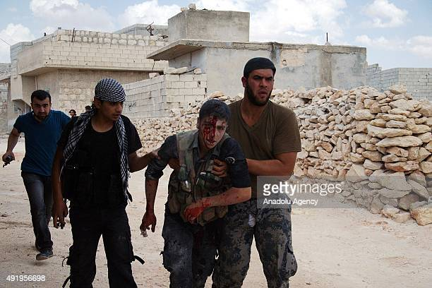 A file photo taken by AA photojournalist Saleh Mahmoud Laila shows a wounded member of Free Syrian Army during the clashes against Syrian regime...