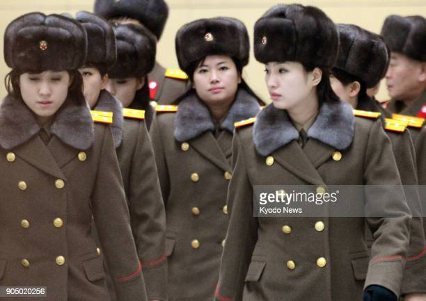 File photo taken Dec 12 shows North Korea's allfemale Moranbong Band led by Hyon Song Wol at Beijing international airport North Korea is considering...