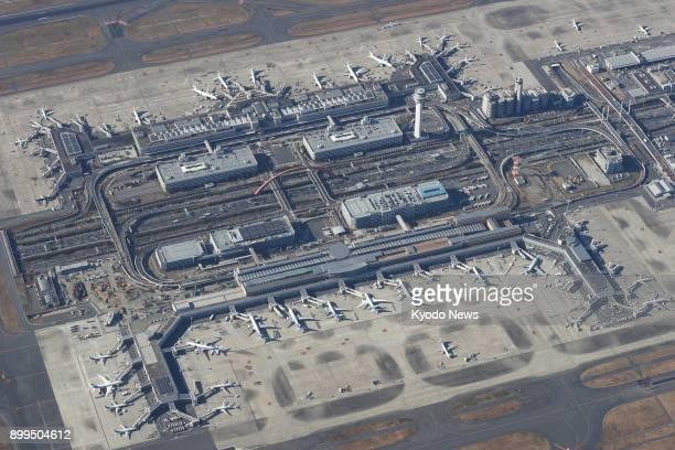 File photo taken Dec 23 shows an aerial view of Terminal 1 and Terminal 2 of Tokyo's Haneda airport ==Kyodo